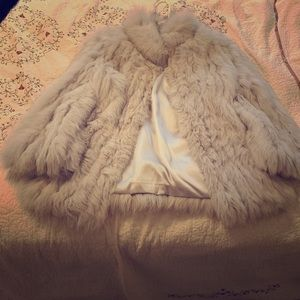 Saga Fox, white fur coat/jacket